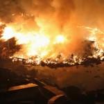 Houses burn at night following an earthquake in Natori City, Miyagi Prefecture, northeastern Japan