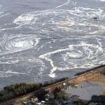 Whirlpools are seen following a tsunami and earthquake in Iwaki city